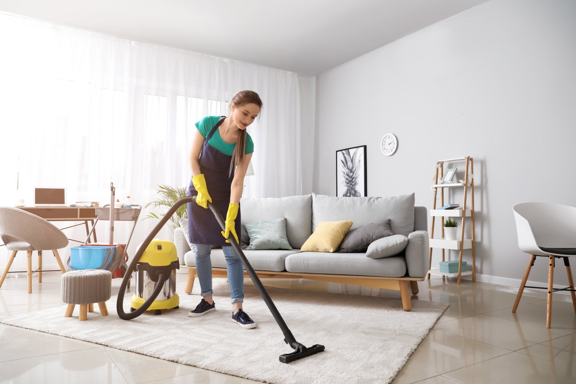 someone doing area rug cleaning with a vacuum