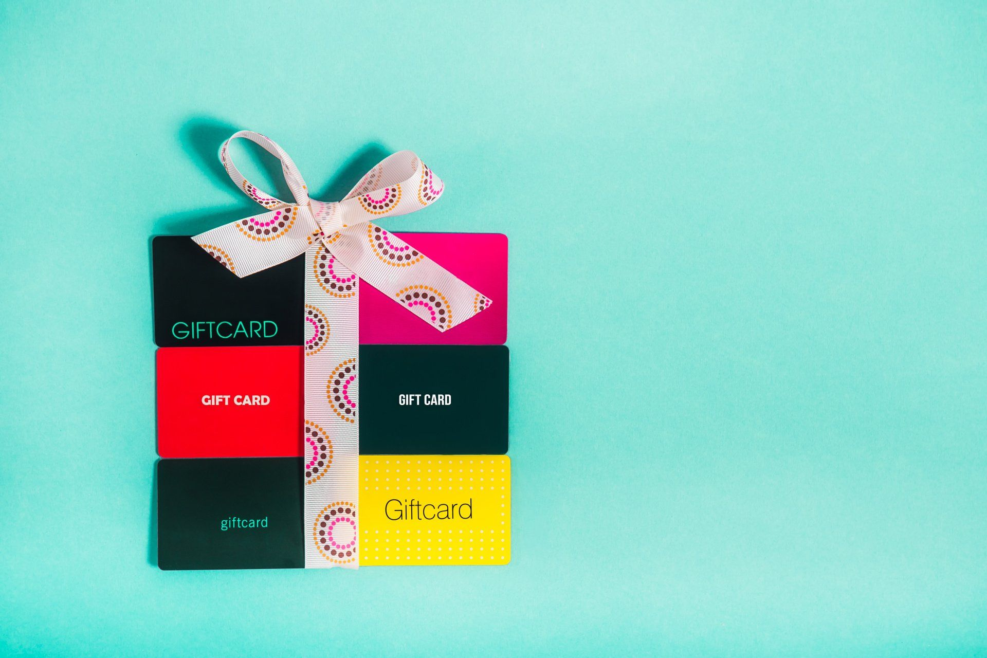 multiple gift cards made to look like a present